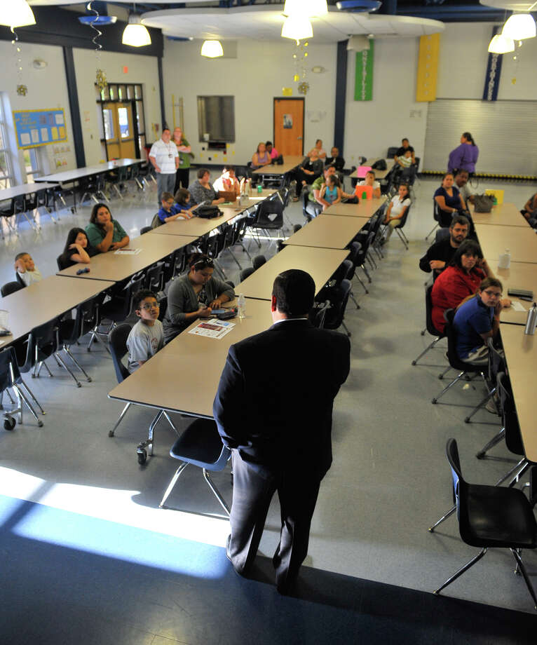 Edgewood ISD Chief Executive of Finance and Operations Eddie Ramirez answers questions about the districts new 6th Grade Academy during a session with parents and students at Roosevelt Elementary School Tuesday evening. Photo: Robin Jerstad