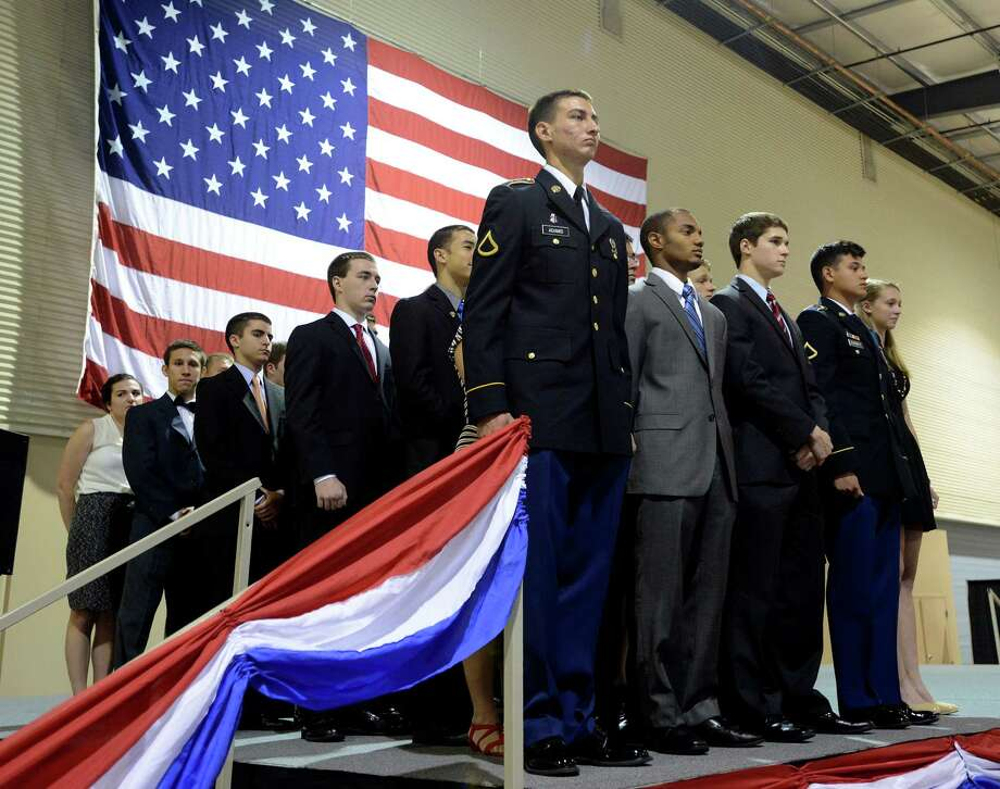Texas high school graduates who will be attending the United States Military Academy stand onstage during U.S. Sen. John Cornyn's annual send-off ceremony for those attending the nation's various military service academies. The event took place at Freeman Coliseum on Memorial Day, May 26, 2014. Major General John F. Nichols gave the keynote address. Medal of Honor recipient Major General Patrick Brady also participated in the event. Photo: Billy Calzada, San Antonio Express-News / San Antonio Express-News