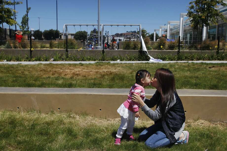 Xiuling Zhao plays with daughter Queenie Huang at the Palega Recreation Center near their home in San Francisco. Photo: Leah Millis, The Chronicle