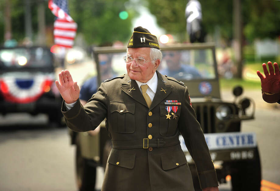 World War 2 and Battle of the Bulge veteran James Morgia, of Stratford, walks the full length of the Stratford Memorial Day Parade in his dress uniform on Main Street in Stratford, Conn. on Monday, May 26, 2014. Photo: Brian A. Pounds / Connecticut Post