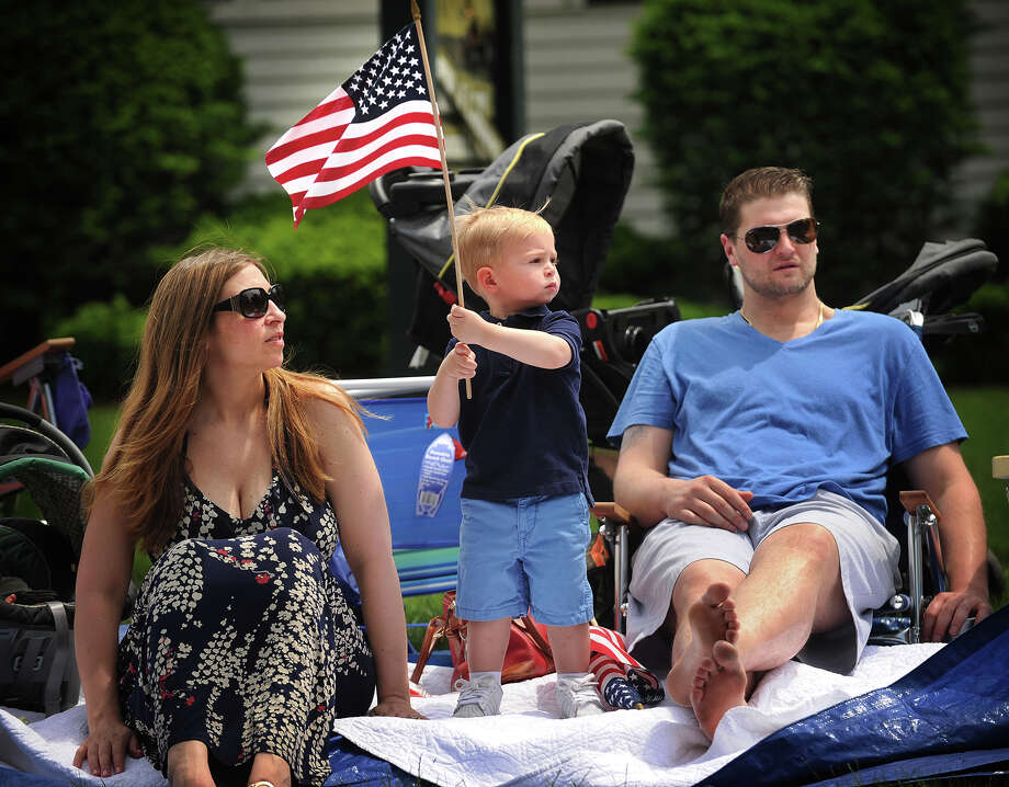 A.J. Newman, 2, of Stratford, waves the American flag as he attends his first Memorial Day Parade with his parents, Marisa and T.J., on Main Street in Stratford, Conn. on Monday, May 26, 2014. Photo: Brian A. Pounds / Connecticut Post
