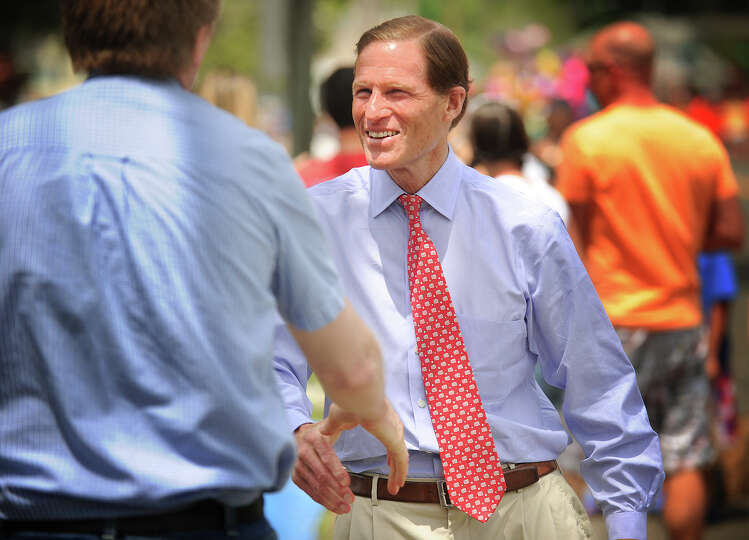 Senator Richard Blumenthal shakes hands with his constituents as he walks the full length of the Str