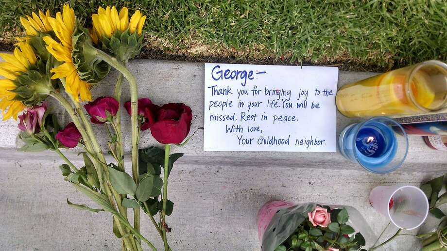 A note mourns George Chen of San Jose outside the apartment building where he was killed in Santa Barbara County. Photo: Christopher Weber, Associated Press