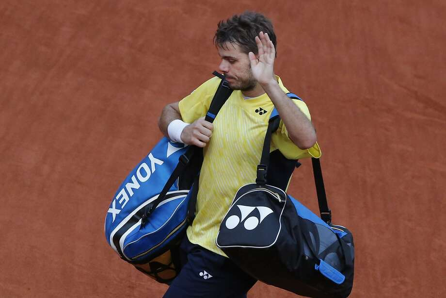 Australian Open champion Stan Wawrinka exits after losing in the first round of the French Open. Photo: Michel Euler, Associated Press