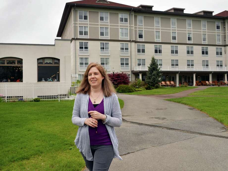 Shelly DeMarsh of Glens Falls makes her way from the Fort William Henry Resort and Conference Center to the Lookout Cafe that she manages Thursday May 22, 2014, in Lake George, NY.  (John Carl D'Annibale / Times Union) Photo: John Carl D'Annibale / 00026980A