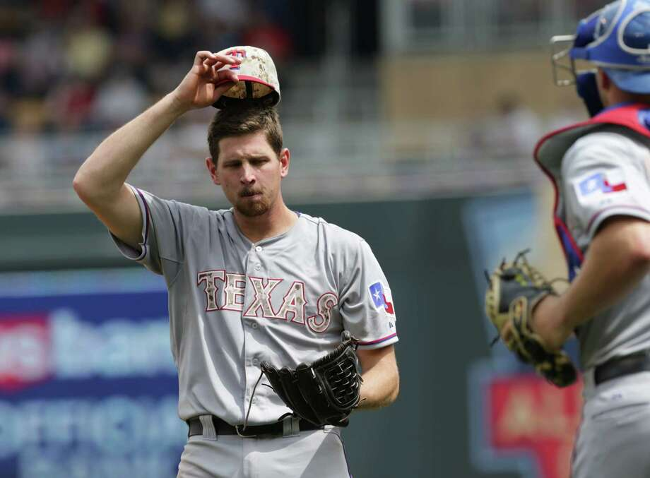 Texas Rangers pitcher Nick Tepesch waits for a visit at the mound from catcher Chris Gimenez in the fifth inning of a baseball game against the Minnesota Twins, Monday, May 26, 2014, in Minneapolis. (AP Photo/Jim Mone) Photo: JIm Mone, Associated Press / AP