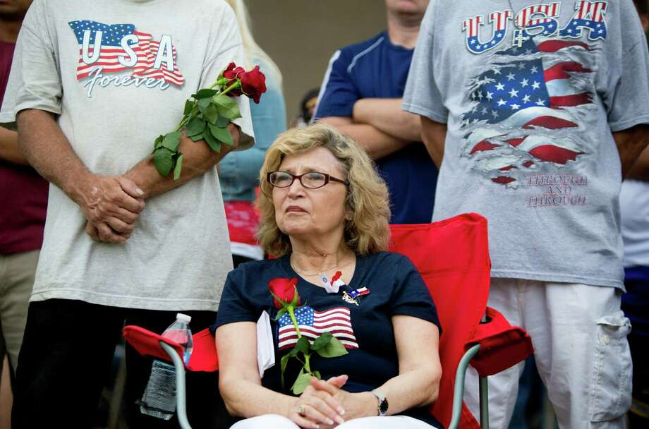 Arlene Levine, center, the wife of a retired U.S Navy Captain listens to the speeches by various dignitaries during the Memorial Day Service at the Houston National Cemetery, Monday, May 26, 2014, in Houston. Photo: Marie D. De Jesus, Houston Chronicle / © 2014 Houston Chronicle