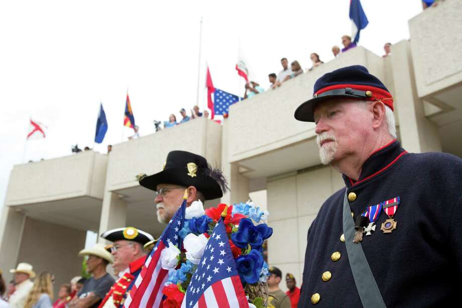 Gary White, right, and David LaBrot, both members of the Edward Lea Camp #2 Sons of the Union Veterans of the Civil War place a floral wreath during the Memorial Day Service at the Houston National Cemetery, Monday, May 26, 2014, in Houston. Photo: Marie D. De Jesus, Houston Chronicle / © 2014 Houston Chronicle