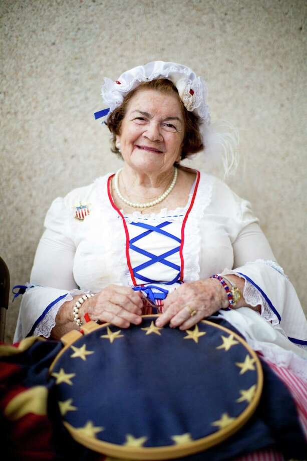 "Virginia ""Ginny"" Evans wears a colonial era costume to the Memorial Day Service at the Houston National Cemetery in remembrance of the American Revolution servicemen and women, Monday, May 26, 2014, in Houston. Photo: Marie D. De Jesus, Houston Chronicle / © 2014 Houston Chronicle"