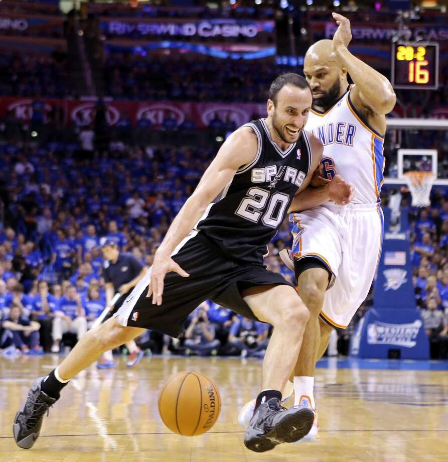 San Antonio Spurs' Manu Ginobili drives around Oklahoma City Thunder's Derek Fisher during second half action in Game 3 of the Western Conference Finals Sunday May 25, 2014 at Chesapeake Energy Arena in Oklahoma City, OK. The Thunder won 106-97. Photo: Edward A. Ornelas, San Antonio Express-News