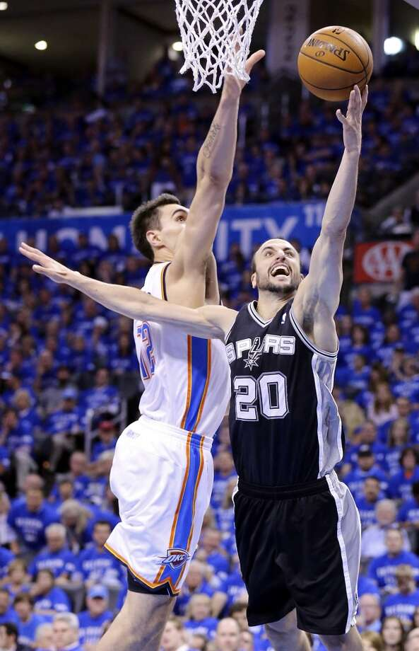 San Antonio Spurs' Manu Ginobili shoots around Oklahoma City Thunder's Steven Adams during first half action in Game 3 of the Western Conference Finals Sunday May 25, 2014 at Chesapeake Energy Arena in Oklahoma City, OK. Photo: Edward A. Ornelas, San Antonio Express-News