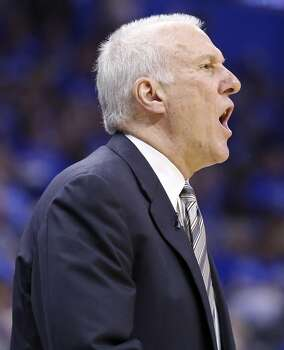 San Antonio Spurs head coach Gregg Popovich calls a play during second half action in Game 3 of the Western Conference Finals against the Oklahoma City Thunder Sunday May 25, 2014 at Chesapeake Energy Arena in Oklahoma City, OK. The Thunder won 106-97. Photo: Edward A. Ornelas, San Antonio Express-News