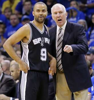 San Antonio Spurs' Tony Parker talks with head coach Gregg Popovichduring first half action in Game 3 of the Western Conference Finals against the Oklahoma City Thunder Sunday May 25, 2014 at Chesapeake Energy Arena in Oklahoma City, OK. Photo: Edward A. Ornelas, San Antonio Express-News