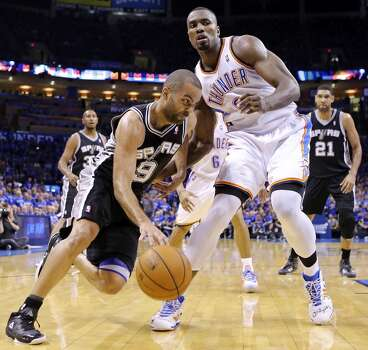 San Antonio Spurs' Tony Parker looks for room around Oklahoma City Thunder's Serge Ibaka during second half action in Game 3 of the Western Conference Finals Sunday May 25, 2014 at Chesapeake Energy Arena in Oklahoma City, OK. The Thunder won 106-97. Photo: Edward A. Ornelas, San Antonio Express-News
