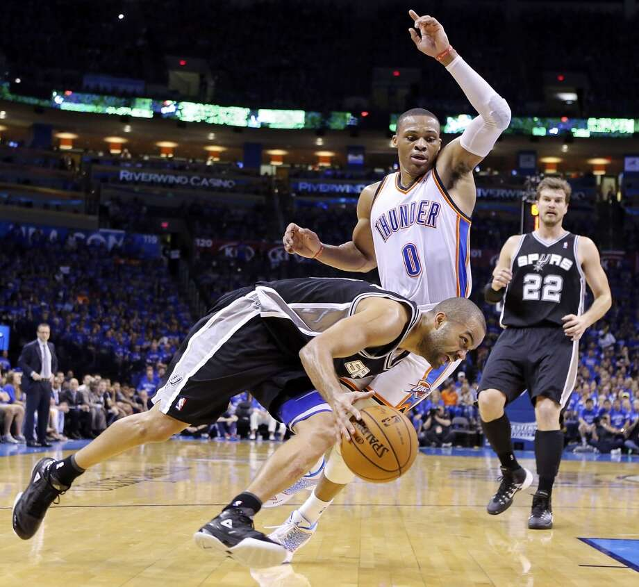 San Antonio Spurs' Tony Parker looks for room around Oklahoma City Thunder's Russell Westbrook during second half action in Game 3 of the Western Conference Finals Sunday May 25, 2014 at Chesapeake Energy Arena in Oklahoma City, OK. The Thunder won 106-97. Photo: Edward A. Ornelas, San Antonio Express-News