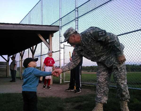 Cameron Primeau of Cohoes, (grandson of city Mayor George Primeau), gets a greeting from Sgt. 1st Class Shawn E. Goggin of the Nw York Army National Guard in Watervliet, of Johnsonville, at the Halfmoon Town Park.   (Nicole Goggin)