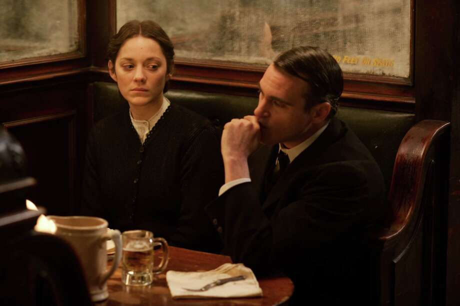 "This photo released by the Weinstein Company shows Marion Cotillard, left, and Joaquin Phoenix, in a scene from the film, ""The Immigrant."" The movie opens in the U.S. with a limited release on May 16, 2014. (AP Photo/The Weinstein Company, Anne Joyce) ORG XMIT: CAET522 Photo: Anne Joyce / The Weinstein Company"