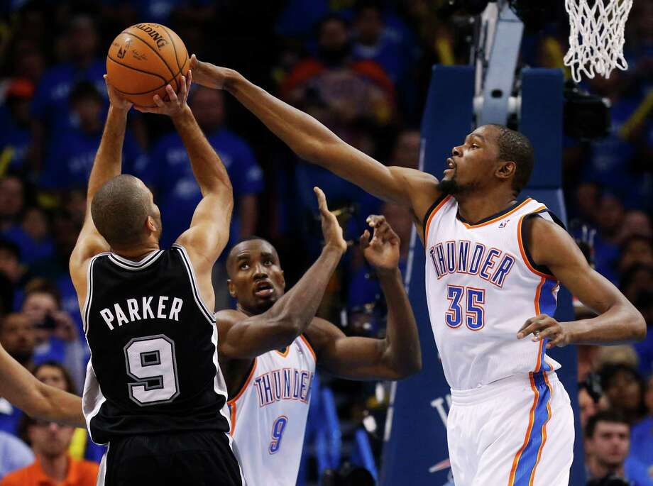 Oklahoma City Thunder forward Kevin Durant (35) blocks a shot by San Antonio Spurs guard Tony Parker (9), of France, in the second quarter of Game 3 of an NBA basketball playoff series in the Western Conference finals, Sunday, May 25, 2014, in Oklahoma City. Oklahoma City won 106-97. (AP Photo/Sue Ogrocki) Photo: Sue Ogrocki, Associated Press / AP