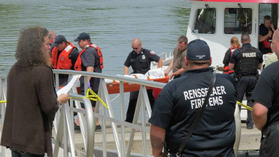 Rescue workers carry the body of Brian Sansone, of Rensselaer, who was found in the Hudson River on 5/26/14. (Photo by Tom Heffernan Sr.)
