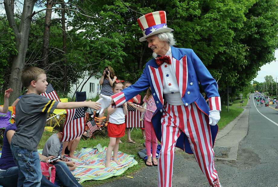 Uncle Sam (Fred Polnisch) shakes hands with Aidan Reagan, 6, of East Greenbush during a Memorial Day parade along Rt. 136 on Monday, May 26, 2014 in North Greenbush, N.Y.  (Lori Van Buren / Times Union) Photo: Lori Van Buren / 00027025A