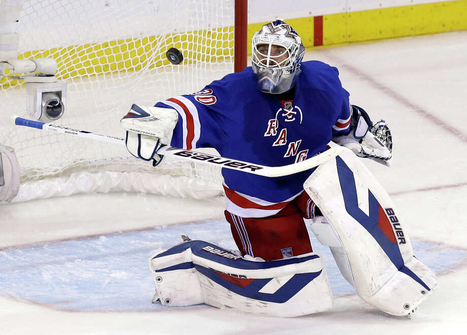 New York Rangers goalie Henrik Lundqvist makes a save during the first period of Game 4 of the NHL hockey Stanley Cup playoffs Eastern Conference finals against the Montreal Canadiens, Sunday, May 25, 2014, in New York. (AP Photo/Seth Wenig) ORG XMIT: MSG303 Photo: Seth Wenig / AP