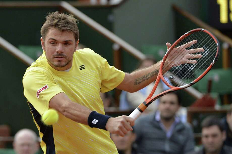 Switzerland's Stanislas Wawrinka hits a return to Spain's Guillermo Garcia-Lopez during their French tennis Open first round match at the Roland Garros stadium in Paris on May 26, 2014. AFP PHOTO / MIGUEL MEDINAMIGUEL MEDINA/AFP/Getty Images ORG XMIT: 492605675 Photo: MIGUEL MEDINA / MIGUEL MEDINA
