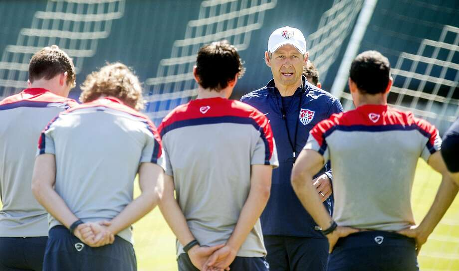 National team coach Jurgen Klinsmann speaks to players at Stanford on Wednesday, the day before he cut Landon Donovan. Photo: Noah Berger, AFP/Getty Images