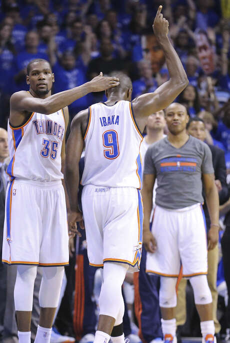 Thunder forward Serge Ibaka limped at times Sunday night, but his effort earned a congratulatory pat from Kevin Durant. Photo: Edward A. Ornelas / San Antonio Express-News / © 2014 San Antonio Express-News