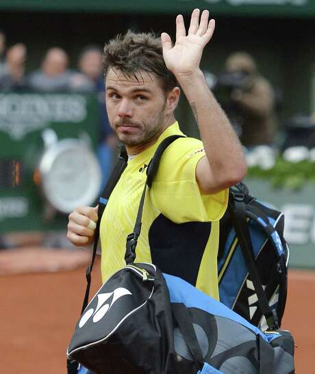 No. 3 Stan Wawrinka bids adieu to the Roland Garros crowd after losing to Guillermo Garcia-Lopez in the first round. Photo: Regis Halbout / Getty Images / MIGUEL MEDINA