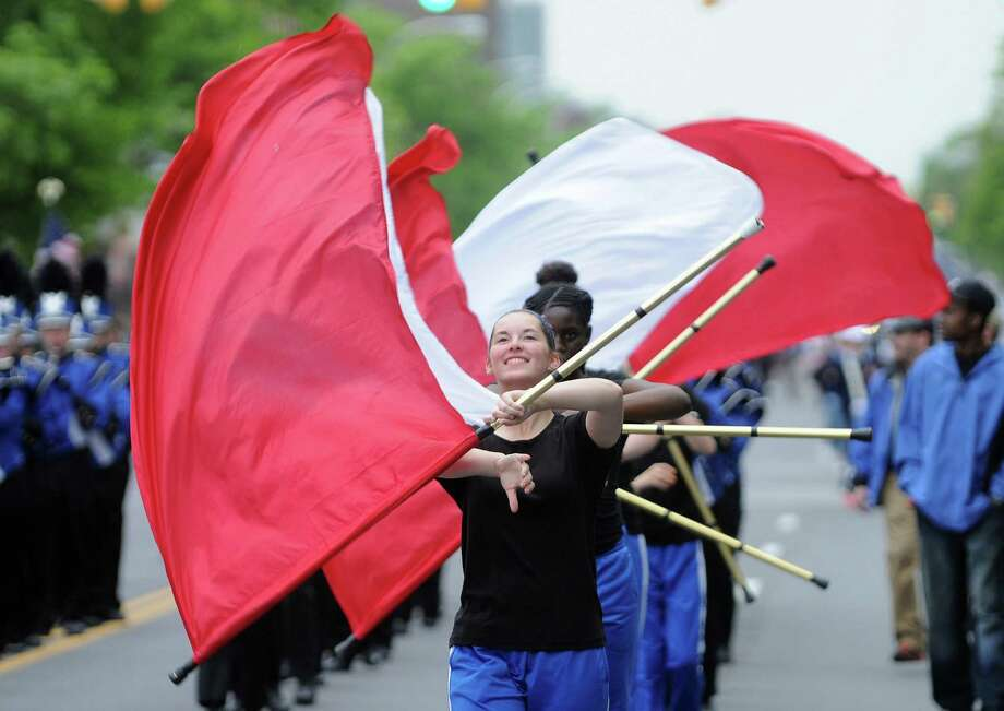 Members of the Albany Marching Falcons band twirl flags as they march down Central Ave. in the Albany Memorial Day Parade on Monday, May 26, 2014, in Albany, N.Y.  (Paul Buckowski / Times Union) Photo: Paul Buckowski / 00027024A