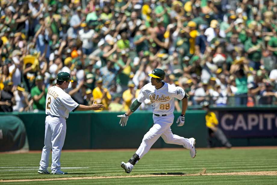Kyle Blanks of the Oakland Athletics is congratulated by third base coach Mike Gallego after hitting a home run off of Drew Smyly of the Detroit Tigers (not pictured) during the second inning at O.co Coliseum on May 26, 2014 in Oakland. Photo: Jason O. Watson, Getty Images