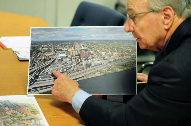 I. David Swawite, right, president and CEO of Omni Development Company, points to an aerial photograph of Albany which shows the proposed site of planned aquarium and technology museum, Tuesday June 18, 2013, at the Times Union in Colonie, N.Y. (Will Waldron/Times Union) Photo: Will Waldron / 10022857A