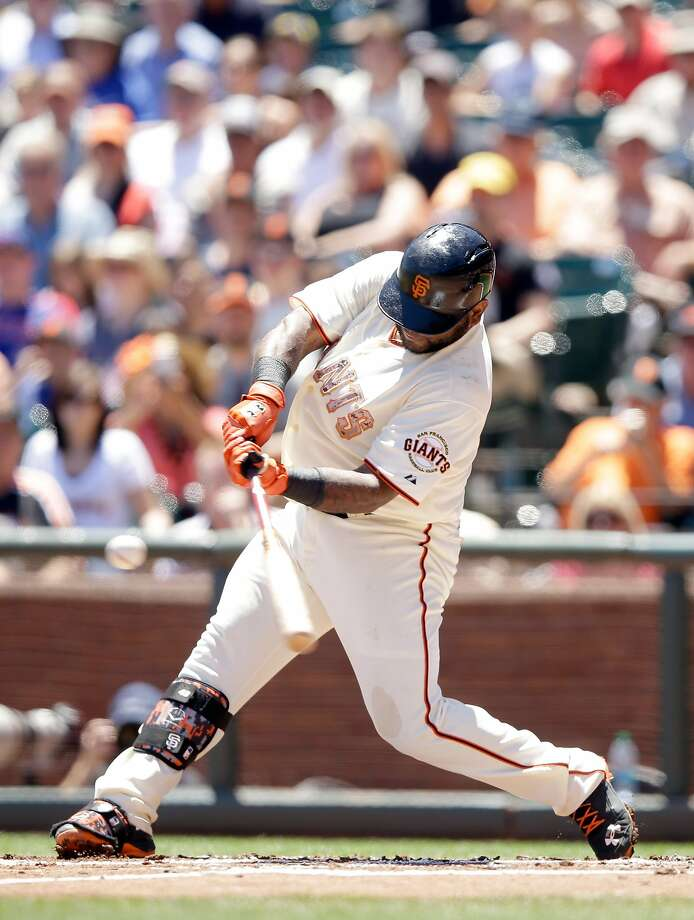 Pablo Sandoval connects on an RBI single in the first and also had a two-run homer. Photo: Ezra Shaw, Getty Images