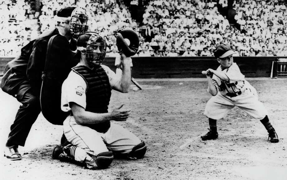 Eddie Gaedel, at 3-foot-7 the shortest player in baseball history, takes a ball during his lone 1951 plate appearance for the St. Louis Browns. Photo: Transcendental Graphics / Getty Images / 1951 Transcendental Graphics