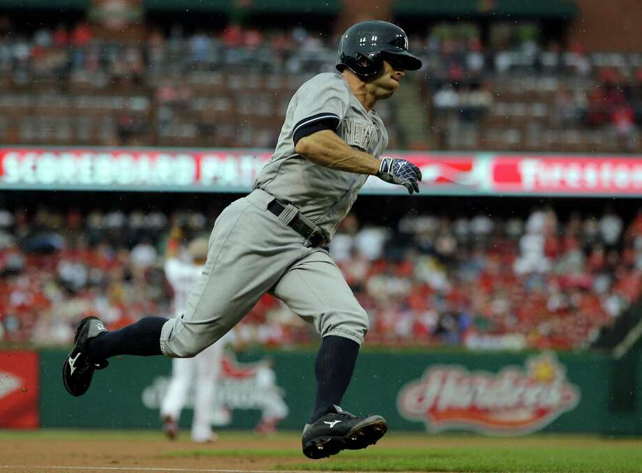 New York Yankees' Brett Gardner runs home to score on a single by Jacoby Ellsbury during the first inning of a baseball game against the St. Louis Cardinals Monday, May 26, 2014, in St. Louis. (AP Photo/Jeff Roberson) ORG XMIT: MOJR106 Photo: Jeff Roberson / AP