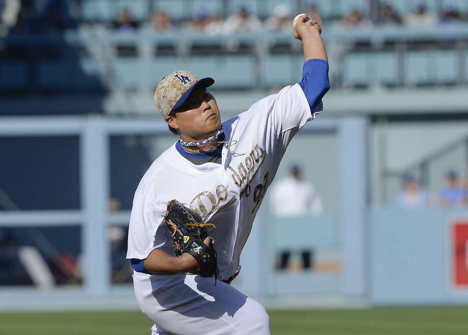 A day after teammate Josh Beckett pitched a no-hitter, Dodgers left-hander Hyun-Jin Ryu had a perfect game for seven innings against the Reds. Photo: Gus Ruelas, Associated Press