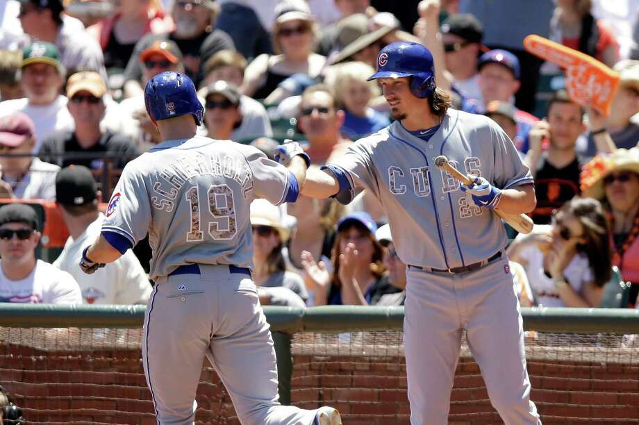 Cubs pitcher Jeff Samardzija (right) congratulates Nate Schierholtz on his first homer of the year. Photo: Ezra Shaw / Getty Images / 2014 Getty Images