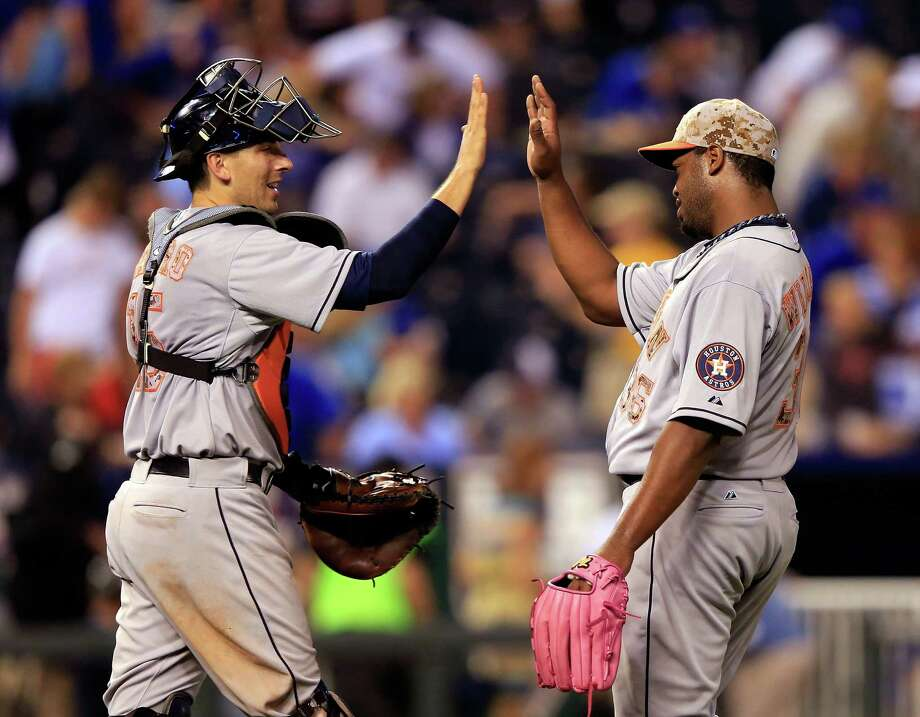 Reliever Jerome Williams, right, earns a high-five from catcher Jason Castro after recording the final out in the Astros' 9-2 victory over the Royals on Monday night. It was the team's third consecutive win. Photo: Jamie Squire, Getty Images / 2014 Getty Images