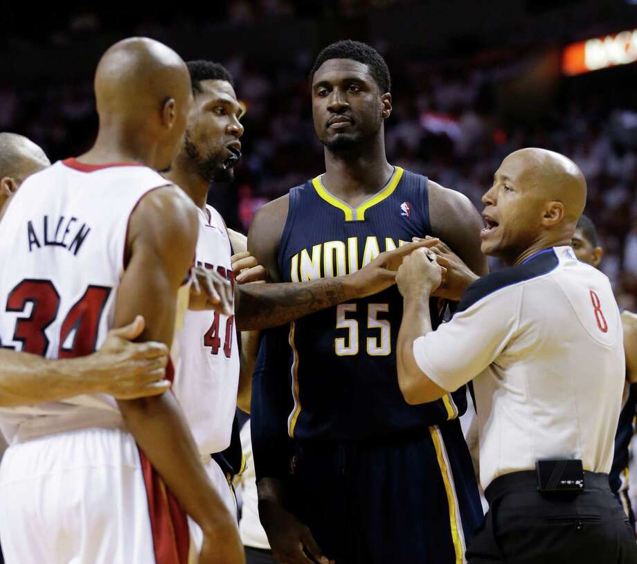 Official Marc Davis, right, and Heat forward Udonis Haslem (40) separate Pacers center Roy Hibbert (55) and Heat guard Ray Allen during a heated moment in the second half of Monday night's game. Photo: Wilfredo Lee, STF / AP