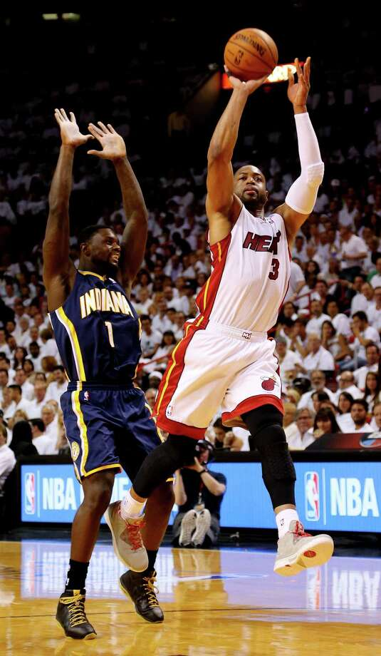 The Heat's Dwyane Wade shoots during Game 4 of the Eastern Conference finals in Miami as the Pacers' Lance Stephenson defends. Wade finished with 15 points, while Stephenson was held to nine. Photo: Mike Ehrmann / Getty Images / 2014 Getty Images