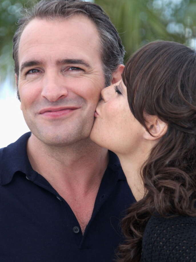 "Actors Jean Dujardin and Berenice Bejo attend ""The Artist"" Photocall at the Palais des Festivals during the 64th Cannes Film Festival on May 15, 2011 in Cannes, France.  He captured the quality the silent stars had, an innocent exuberance, as though nothing bad could ever happen to them. Photo: Tony Barson, WireImage / 2011 Tony Barson"