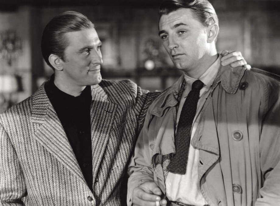 Two bird with one stone here:   Kirk Douglas and Robert Mitchum in a scene of the noir movie 'Out of the Past', from 1947, directed by Jacques Tourneur.  This became one of the iconic Mitchum performances, but Douglas was great, too -- genuinely menacing as a gangster, even though he never does anything bad in the entire movie. Photo: Mondadori, Mondadori Via Getty Images / Mondadori