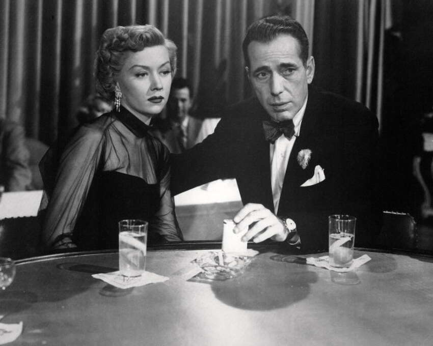 Humphrey Bogart (with Gloria Grahame) in IN A LONELY PLACE (1950), which features him in one of his best (and most atypical) performances. So much of what Bogart did in his brief dozen or so years of stardom is unforgettable, including CASABLANCA, THE BIG SLEEP and KEY LARGO. Photo: Silver Screen Collection, Getty Images / 2013 Getty Images