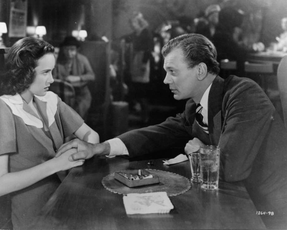 Joseph Cottenreaches across the table to hold Teresa Wright's hand in a scene from the 1943 film 'Shadow Of A Doubt.' A wonderful menacing performance. Photo: Archive Photos, Getty Images / 2012 Getty Images