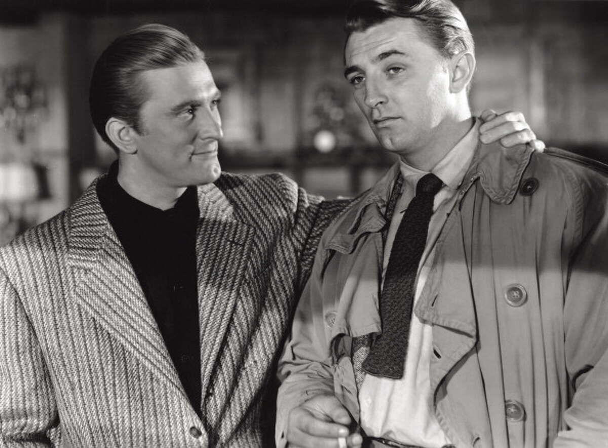 1947: Two bird with one stone here: Kirk Douglas and Robert Mitchum in a scene of the noir movie 'Out of the Past', from 1947, directed by Jacques Tourneur. This became one of the iconic Mitchum performances, but Douglas was great, too -- genuinely menacing as a gangster, even though he never does anything bad in the entire movie.