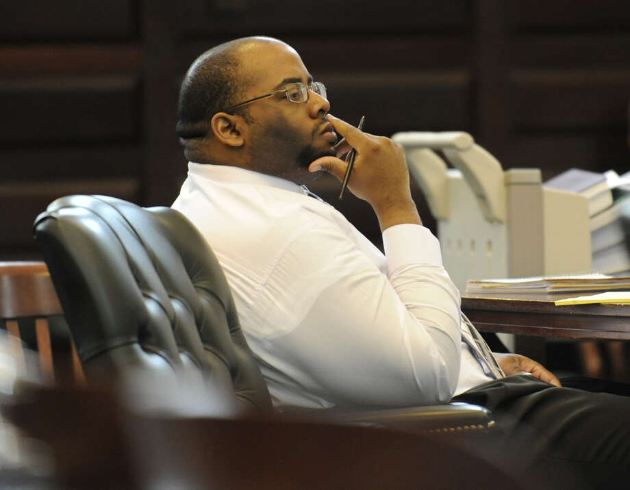 Adrian Thomas listens to the opening statements at his first trial in Rensselaer County Courthouse in Troy, New York October 2, 2009.    (Skip Dickstein / Times Union archive) Photo: SKIP DICKSTEIN / 00005768A