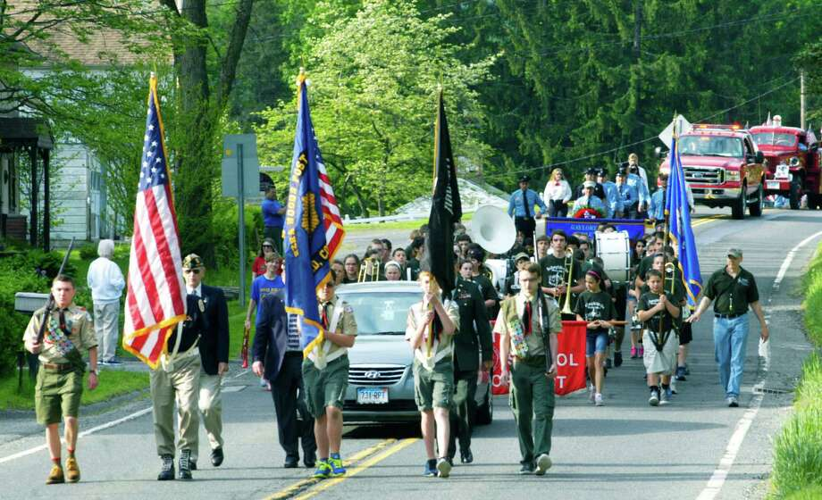 John Avalone, partially hidden, of New Milford's American Legion Post 31 bears the Stars and Stripes as he leads the Honor Guard along Route 7 in Gaylordsville's Memorial Day parade, May 26, 2014. Flanking him are, from left to right, Eric Winkelstern, Kevin Stowell, Zack Cyr and Ryan Lynch of Boy Scout Troop 31. Photo: Norm Cummings / The News-Times