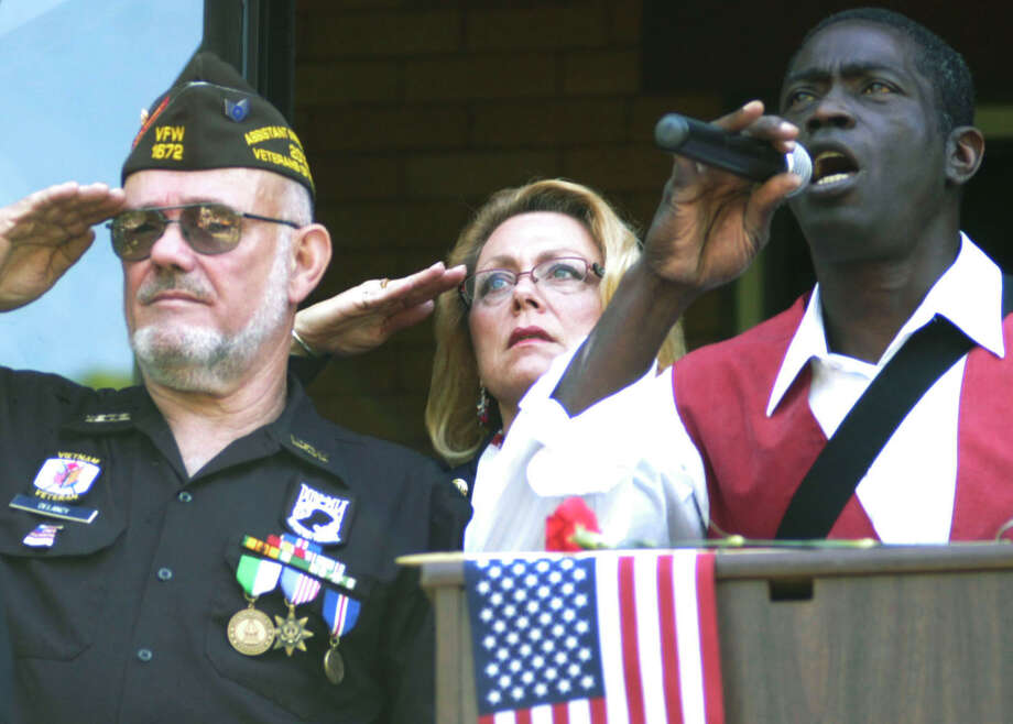 Curtis Thompson pours his heart into a stirring rendition of The Star Spangled Banner during New Milford's Memorial Day ceremony as Mayor Pat Murphy and American Legion Post 31's and James Delancy hold their salute, May 26, 2014 Photo: Norm Cummings / The News-Times