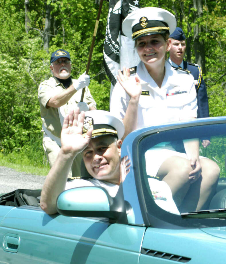 U.S. Naval Academy Midshipman Rachel Berger of Sherman, and her father, Michael, lead the Sherman NMemorial Day parade along Route 39 north into the village center. May 25, 2014. Photo: Norm Cummings / The News-Times