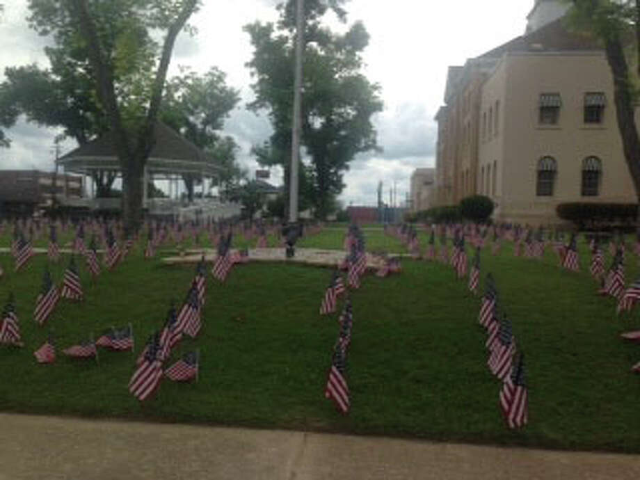 Flags representing Texas Fallen soldiers at the Courthouse. photo by Shannon Stott